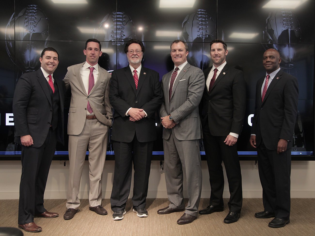Left to right: Jed York, Shanahan, John York, Lynch, Peters and Mayhew