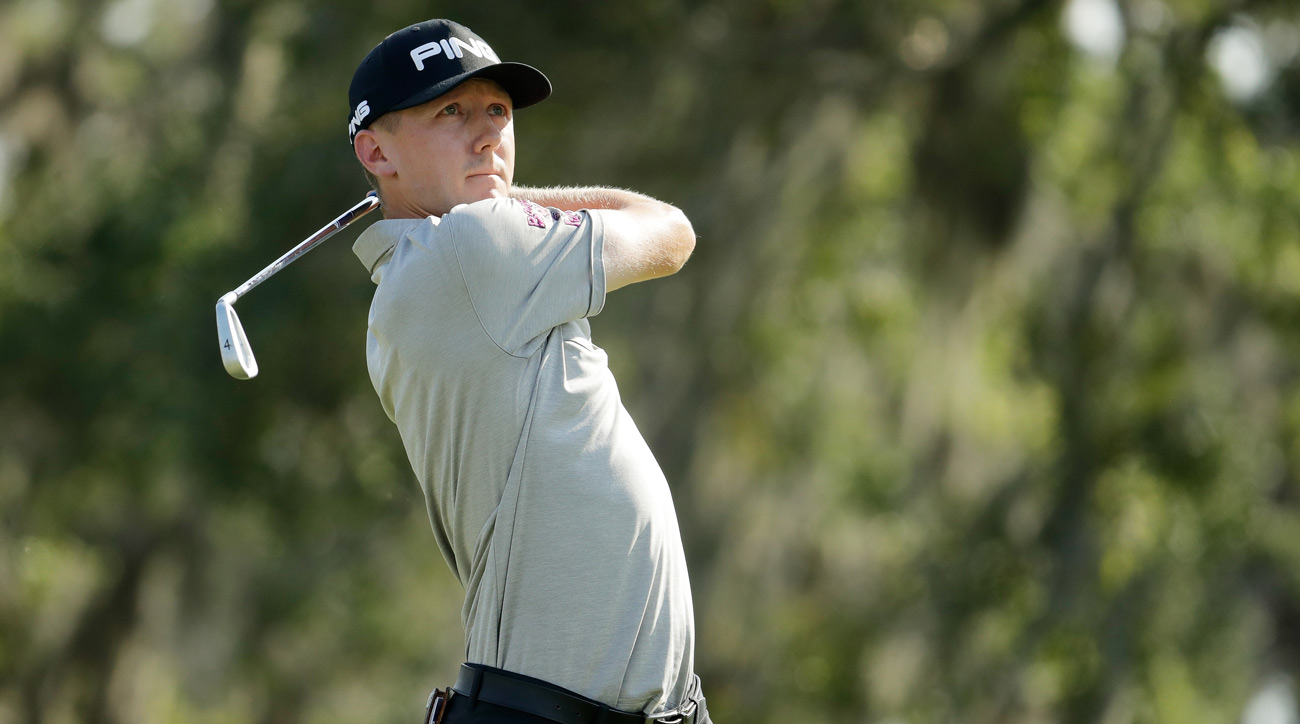 Mackenzie Hughes of Canada plays his shot from the 12th tee during the first round of the Players Championship.