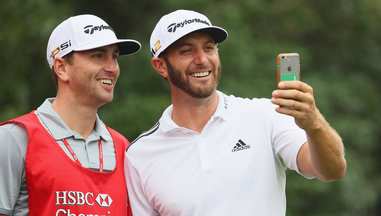Dustin and Austin Johnson take a moment to smile for a selfie.