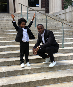 Andrew Hawkins and his 5-year-old son, Austin, at the Columbia graduation.