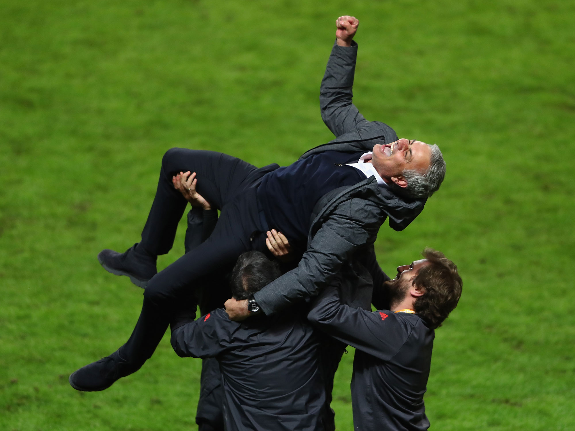 Jose Mourinho is lifted up after Manchester United wins the Europa League