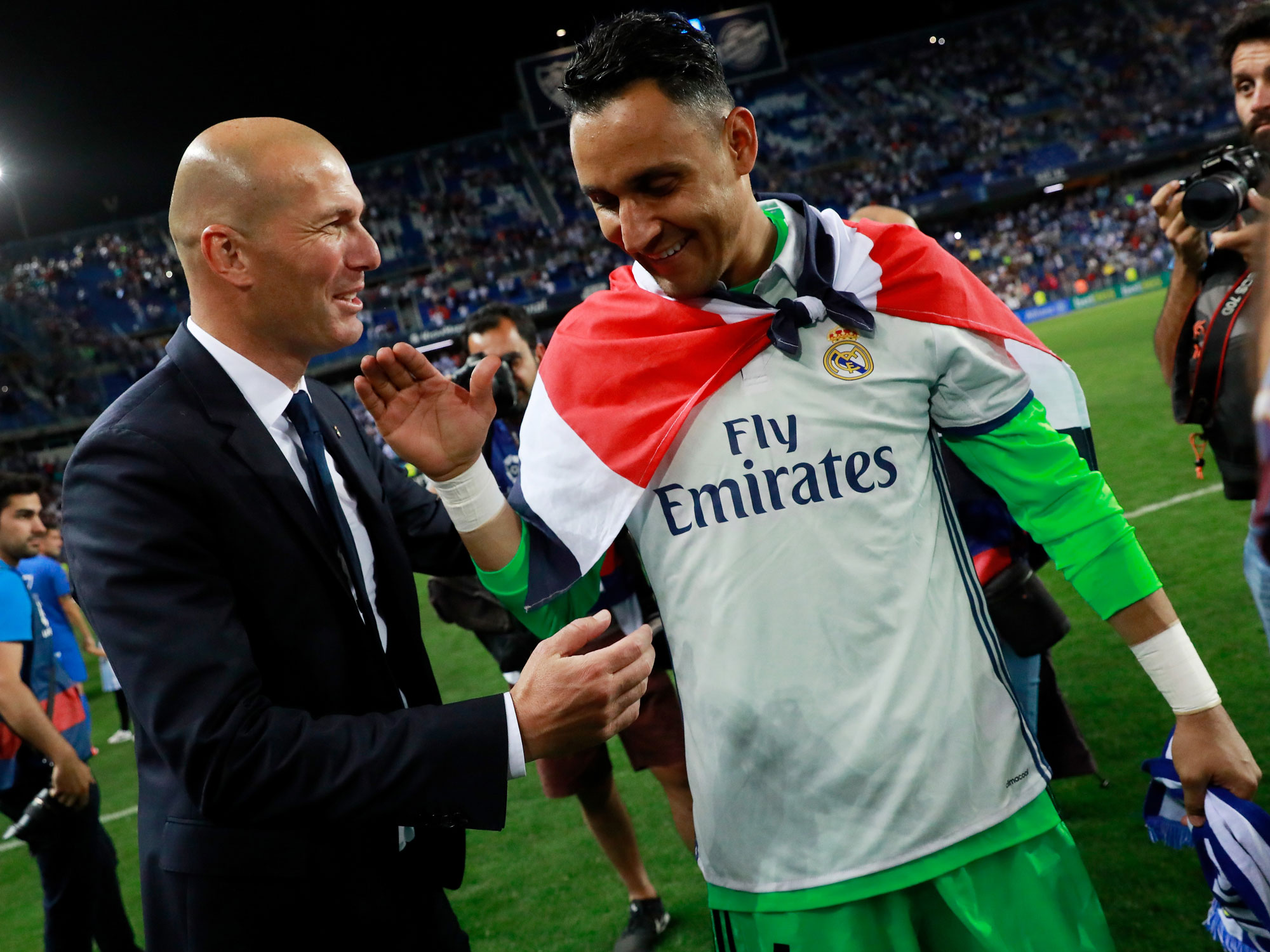 Keylor Navas and Zinedine Zidane celebrate winning La Liga