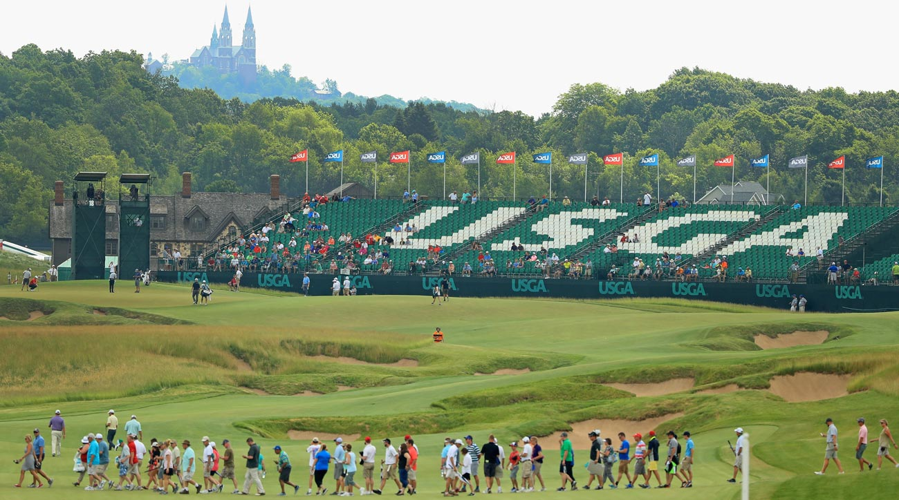 Fans walk across the course during a practice round prior to the 2017 U.S. Open at Erin Hills.