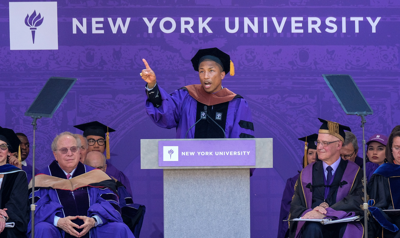 Pharrell Williams gave the commencement address at NYU, which also gave the musician an honorary doctorate.
