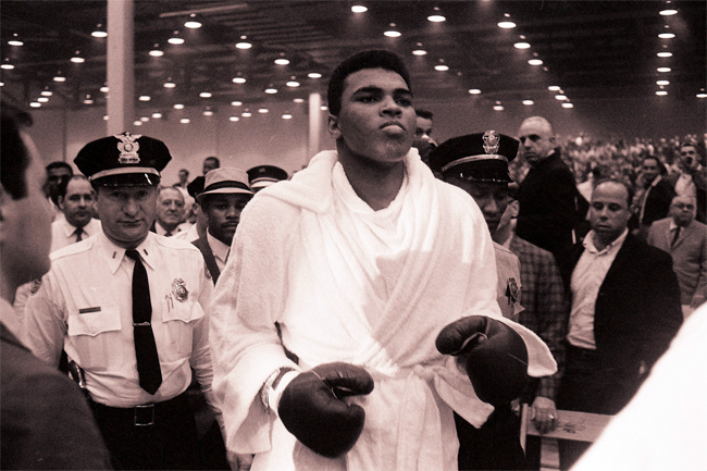 Cassius Clay walks to the ring for his February 1964 heavyweight title fight against Sonny Liston in Miami.