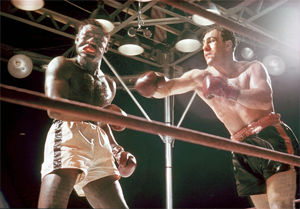 Rocky Marciano (r.) in a heavyweight title bout against Ezzard Charles at Yankee Stadium in 1954.
