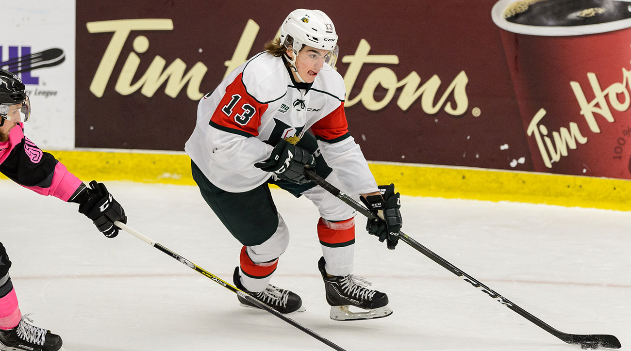 Nico Hischier #13 of the Halifax Mooseheads skates the puck against Pascal Corbeil #55 of the Blainville-Boisbriand Armada during the QMJHL game at the Centre d'Excellence Sports Rousseau on October 15, 2016 in Boisbriand, Quebec, Canada.