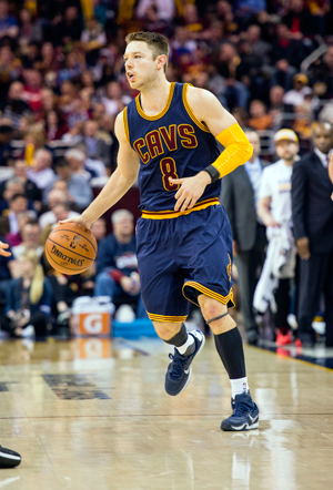 Matthew Dellavedova, wearing a WHOOP device on his left wrist, runs the point for the Cavaliers in March 2016.