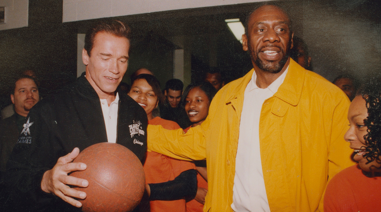 Walker (right), who brought in Arnold Schwarzenegger and other celebrities to ceremonies held for his Chicago league, knew the value of adding some glitz to midnight basketball.