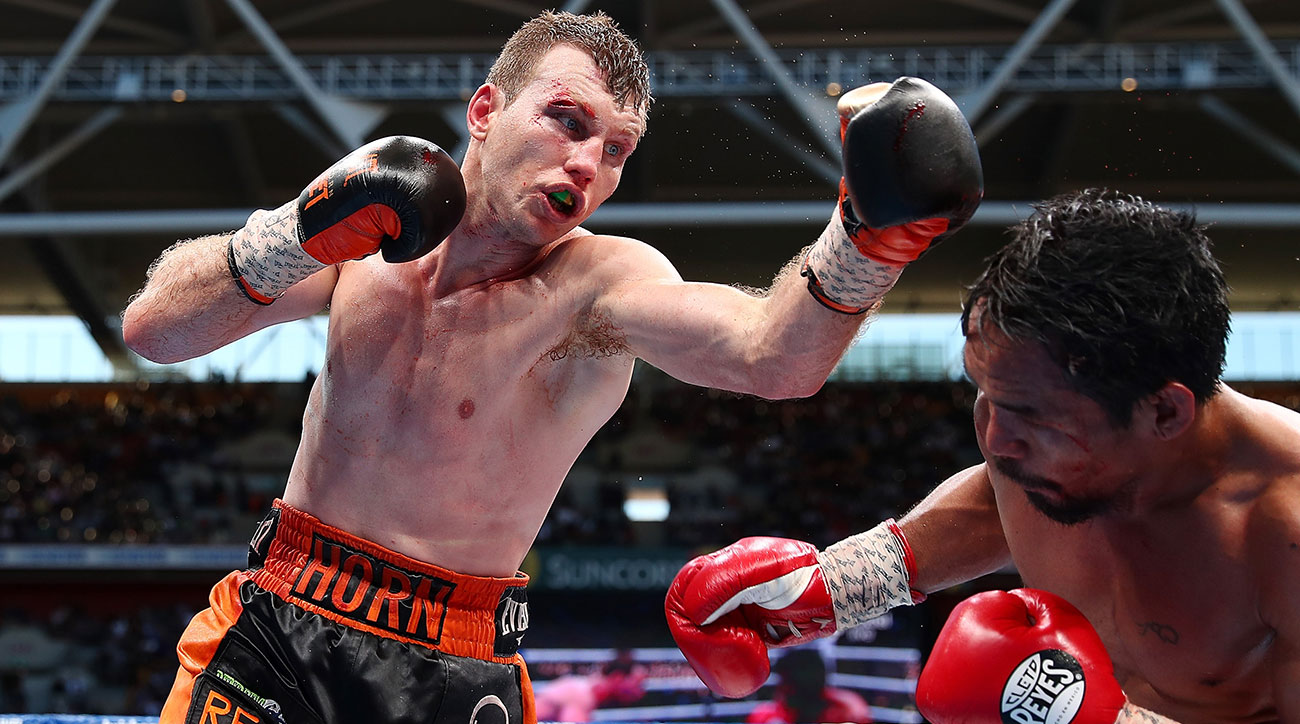 Jeff Horn of Australia punches Manny Pacquiao during the WBO World Welterweight Title Fight at Suncorp Stadium on July 2, 2017 in Brisbane, Australia. (Photo by Chris Hyde/Getty Images)