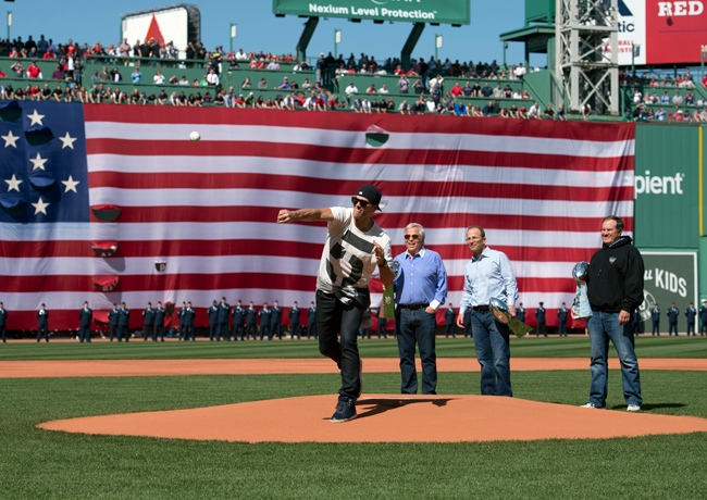 Tom Brady throws out a ceremonial first pitch at Fenway Park on Opening Day in 2015.