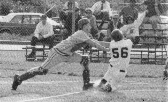 As a JV catcher in 1993, Brady applies the tag at home.