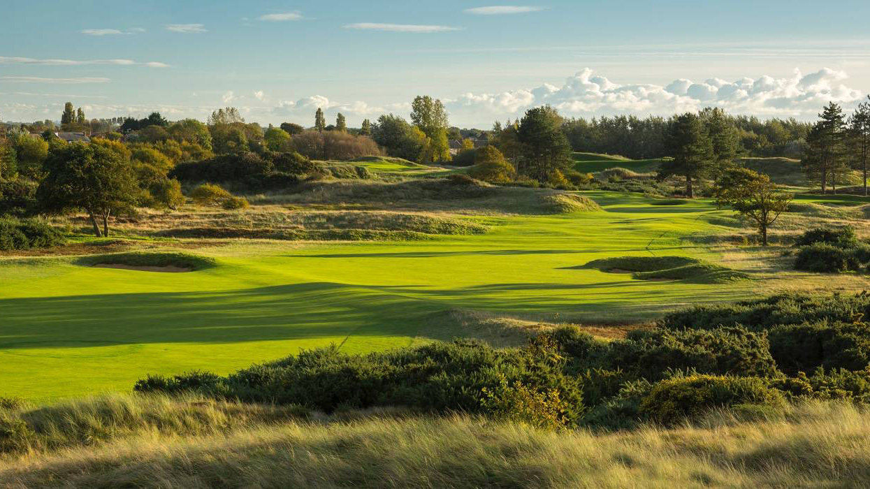 Best known as the venue for the 1933 and 1937 Ryder Cup Matches, this 1923 James Braid design witnessed one of the more humorous, if pivotal incidents in Cup history in the '37 Match. Gene Sarazen, and Percy Alliss were all square at 15, when Sarazen's approach carried through the green and landed in a woman's lap. She leaped up in surprise, and the ball rolled close to the hole. Sarazen birdied to win the hole and later the match. The par-3 8th, with its plateau green, the par-5 16th, among the sandhills, are standouts. $84-$168