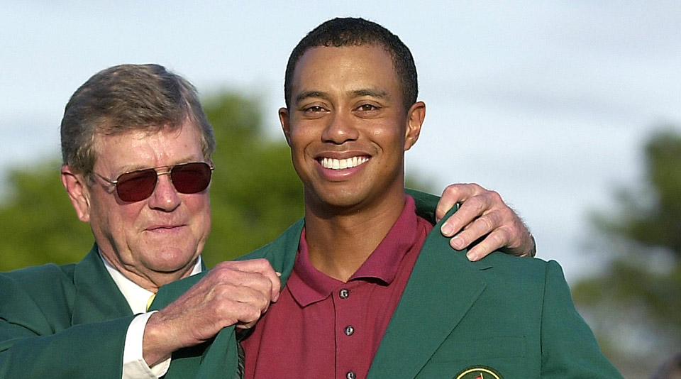 Johnson helped Tiger Woods don his third green jacket in 2002.