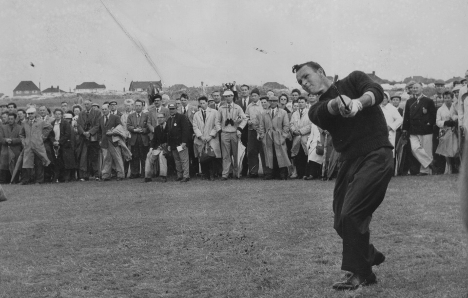 Arnold Palmer plays an approach shot on the first hole at Royal Birkdale during the 1961 Open.
