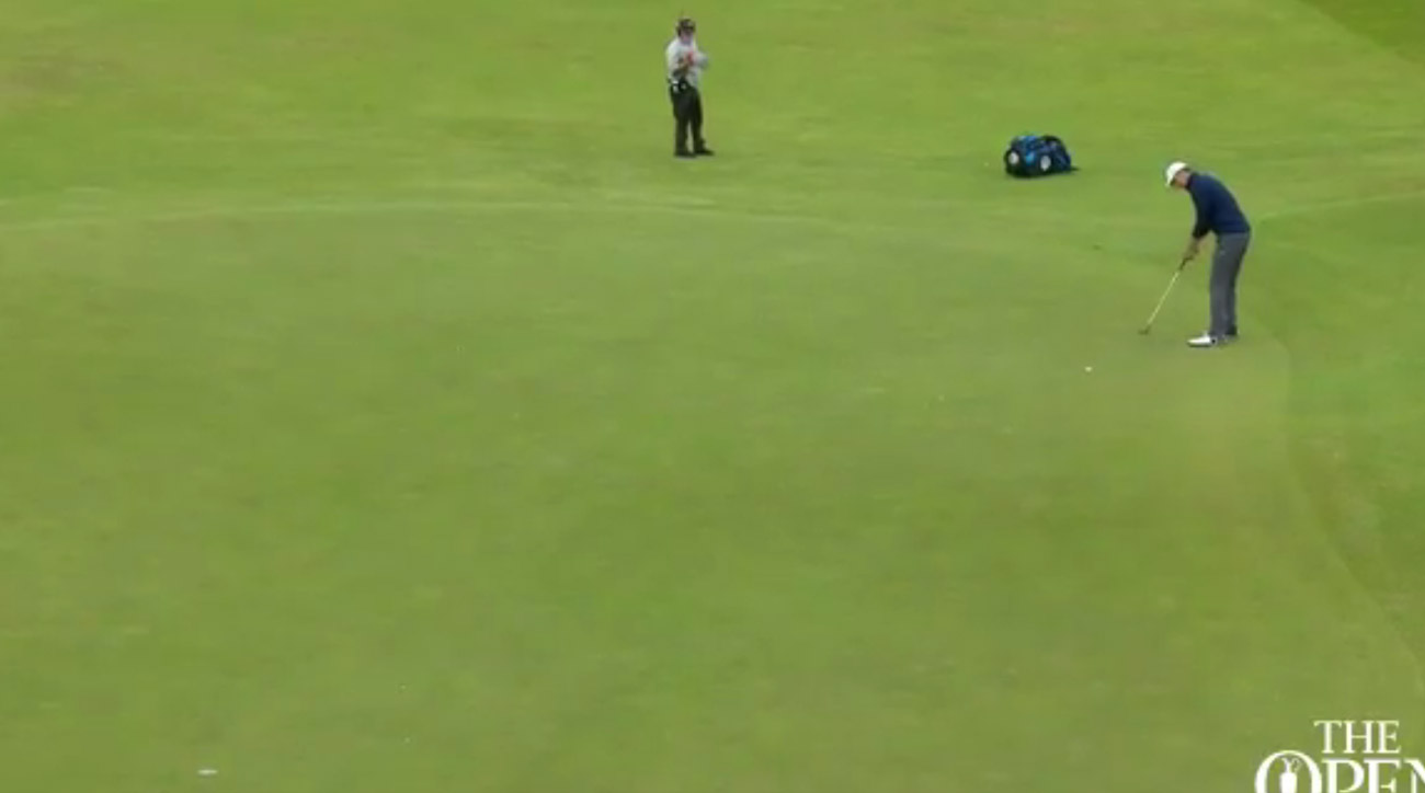Jordan Spieth hits a putt for eagle on the 15th hole.