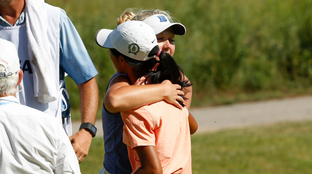 Erica Shepherd (left) hugs Elizabeth Moon after a ruling on an unconceded putt abruptly ended their match on the first playoff hole.