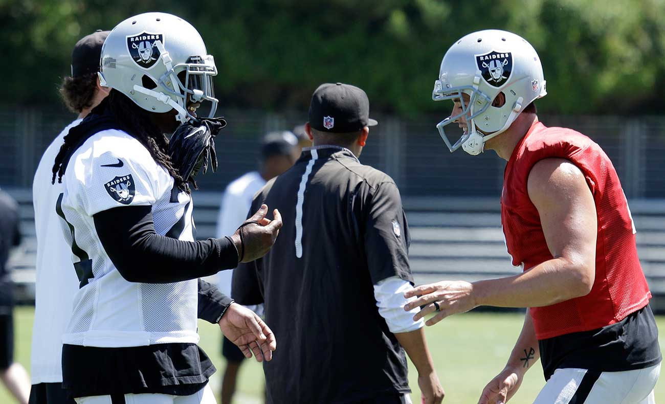 Lynch and Carr strategize at Raiders camp in Napa.