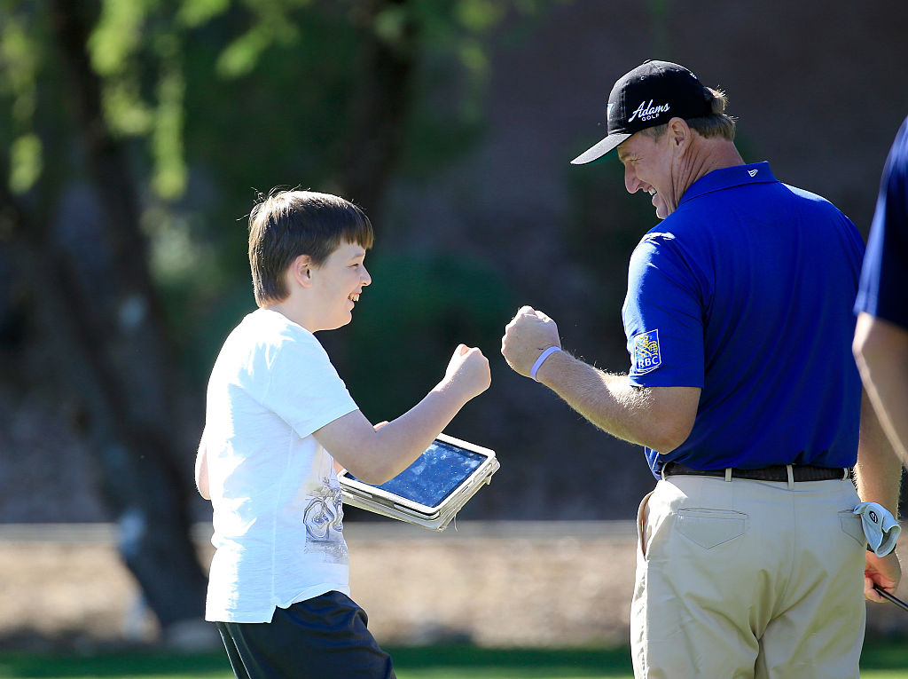 Ernie and Ben were father/son fist-bumpers in 2015 at the SAP Invitational Golf Day.