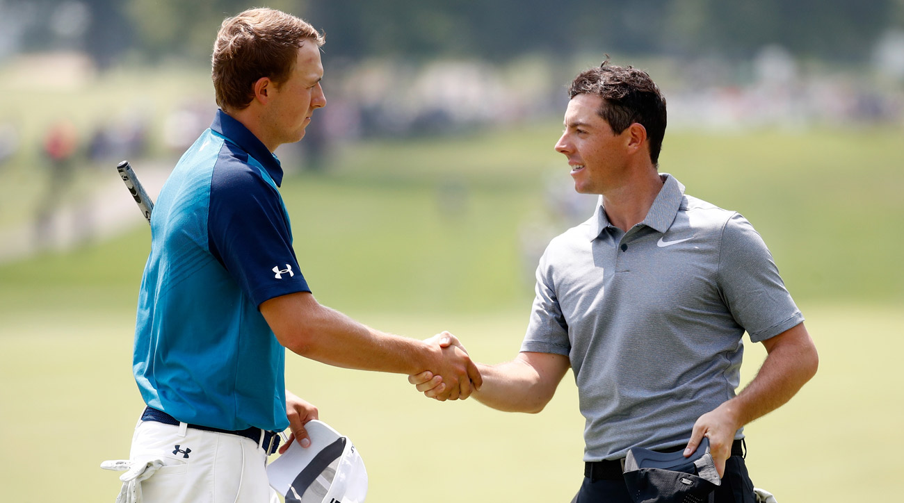 Jordan Spieth and Rory McIlroy shake hands on the ninth green during the first round of the WGC-Bridgestone Invitational.