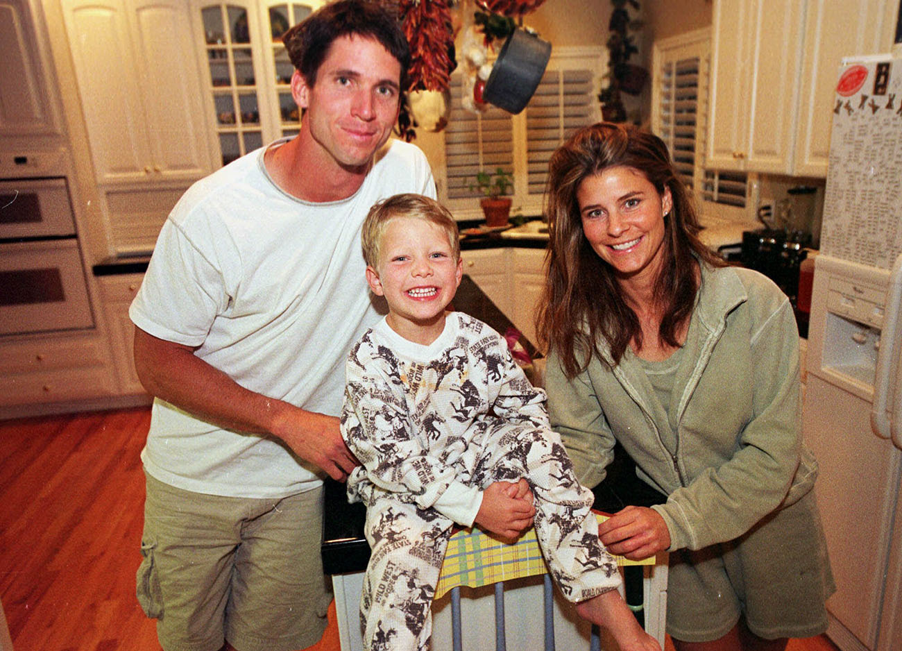A 5-year-old Christian with mom and dad in 2000.