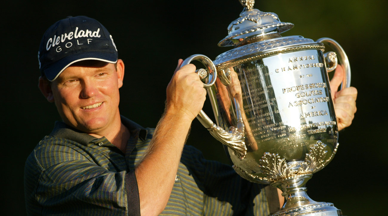Micheel hoists the Wanamaker trophy after winning the 2003 PGA at Oak Hill.