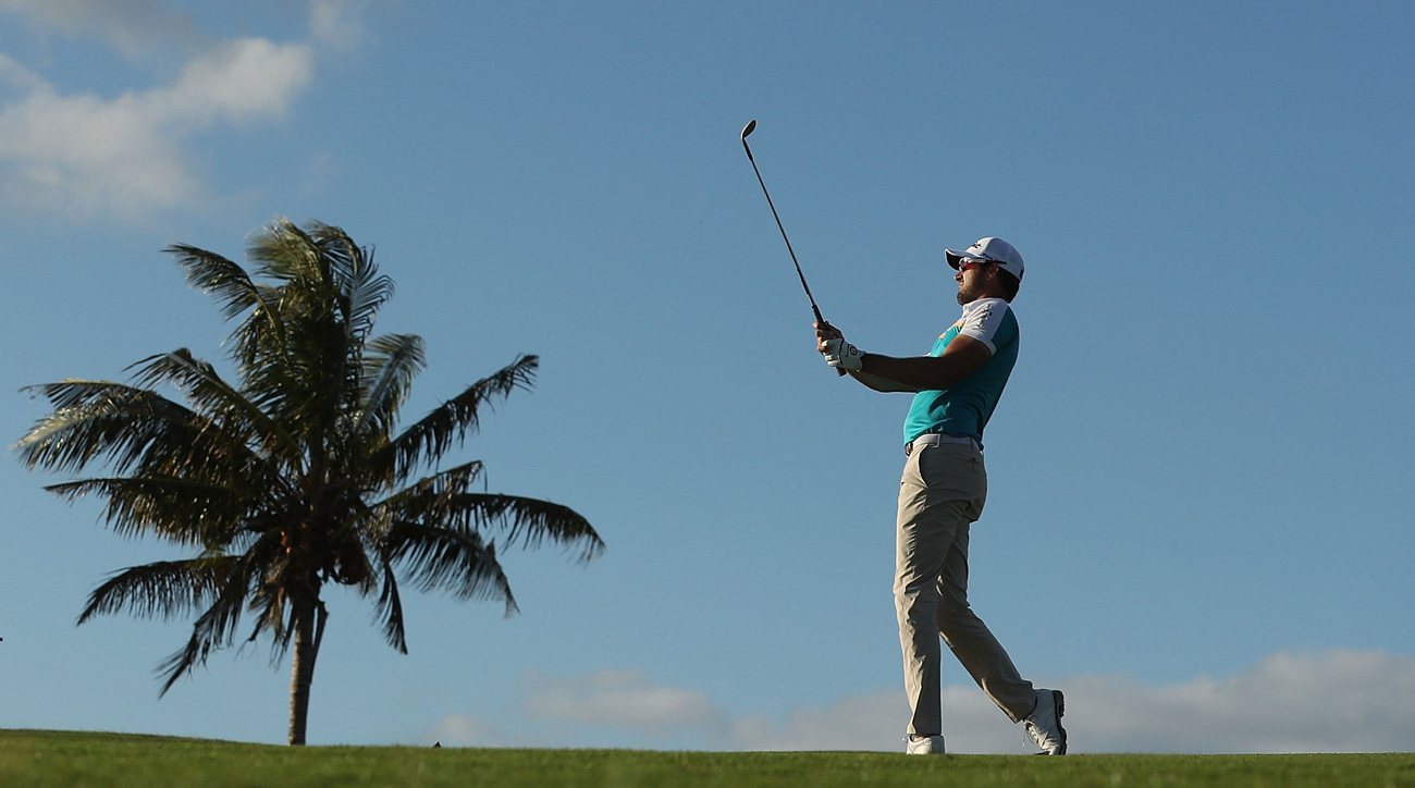 Daniel Pearce hits his approach shot on the 7th hole during day one of the 2017 Fiji International.