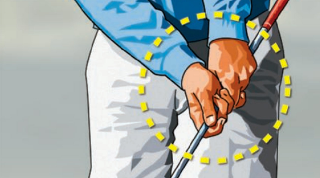 """Hold your wedge halfway down the shaft and make some practice chipping swings. If you try to """"flip"""" the clubhead past your hands at impact—a no-no—the grip end of the shaft will hit you in the side."""