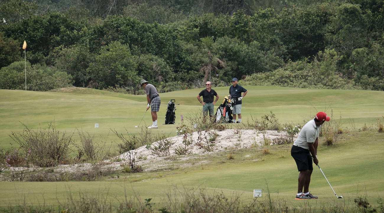 Golfers play on the Olympic golf course in Rio de Janeiro, Brazil, on November 23, 2016.