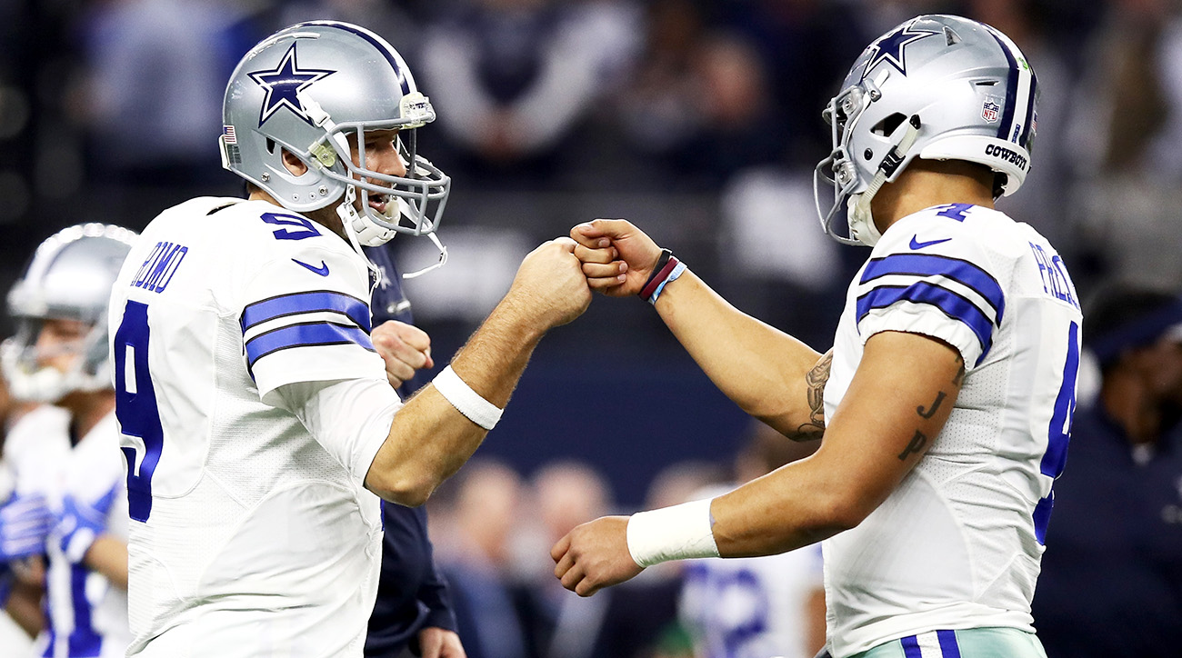 Romo (left) and Prescott during warmups before January's divisional playoff game against the Packers, Romo's last game as an NFL player.