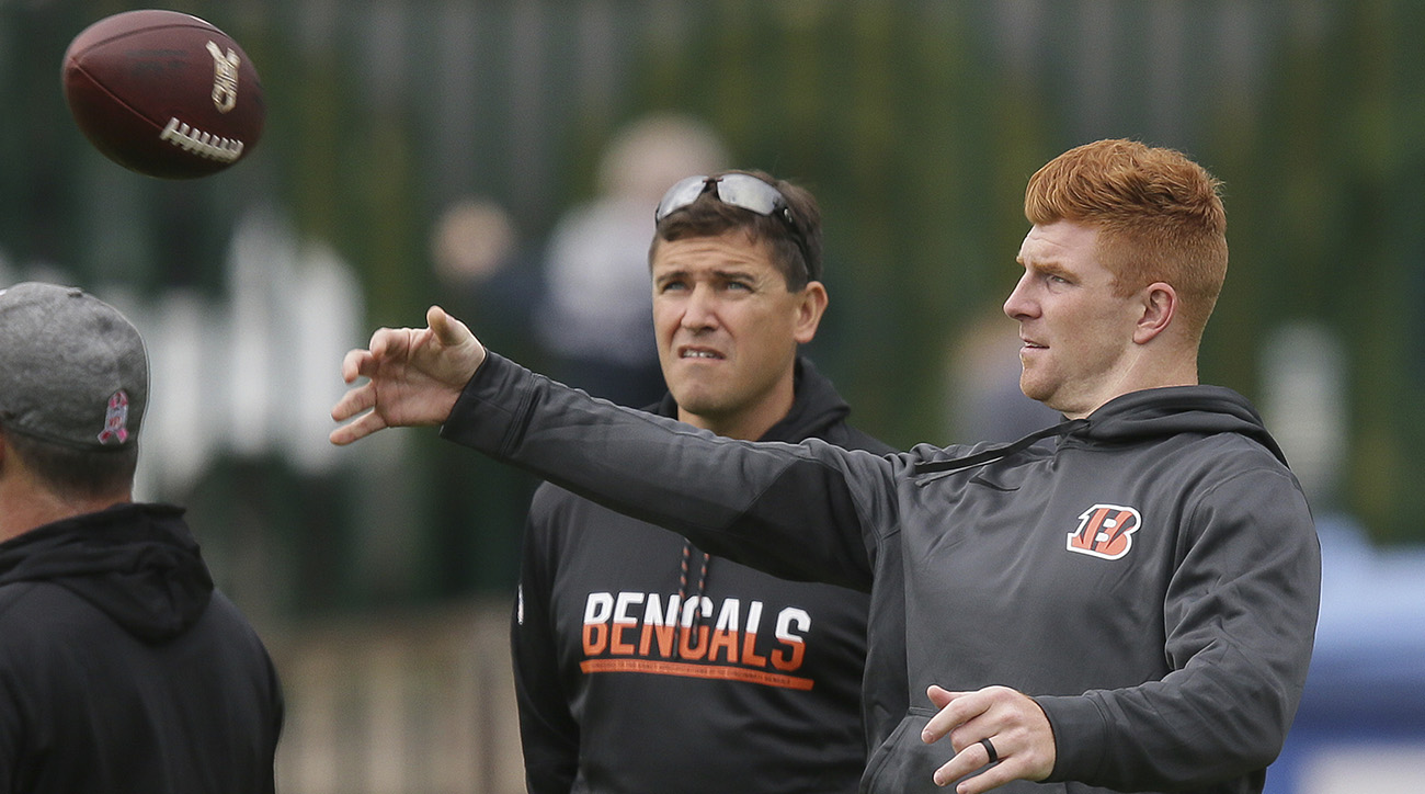 Lazor with Andy Dalton while they prepared to play Washington in London last season.