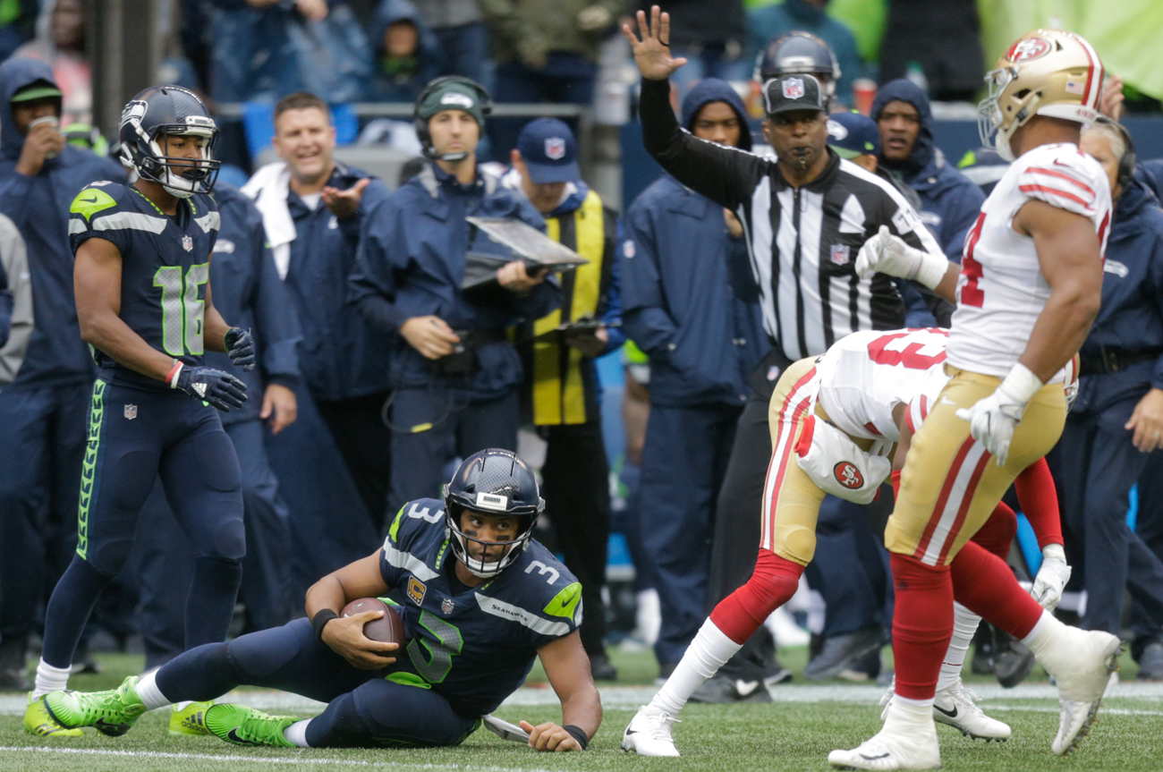 Russell Wilson frequently was on the run to avoid the rush in the Seahawks' 12-9 win over the 49ers on Sunday.