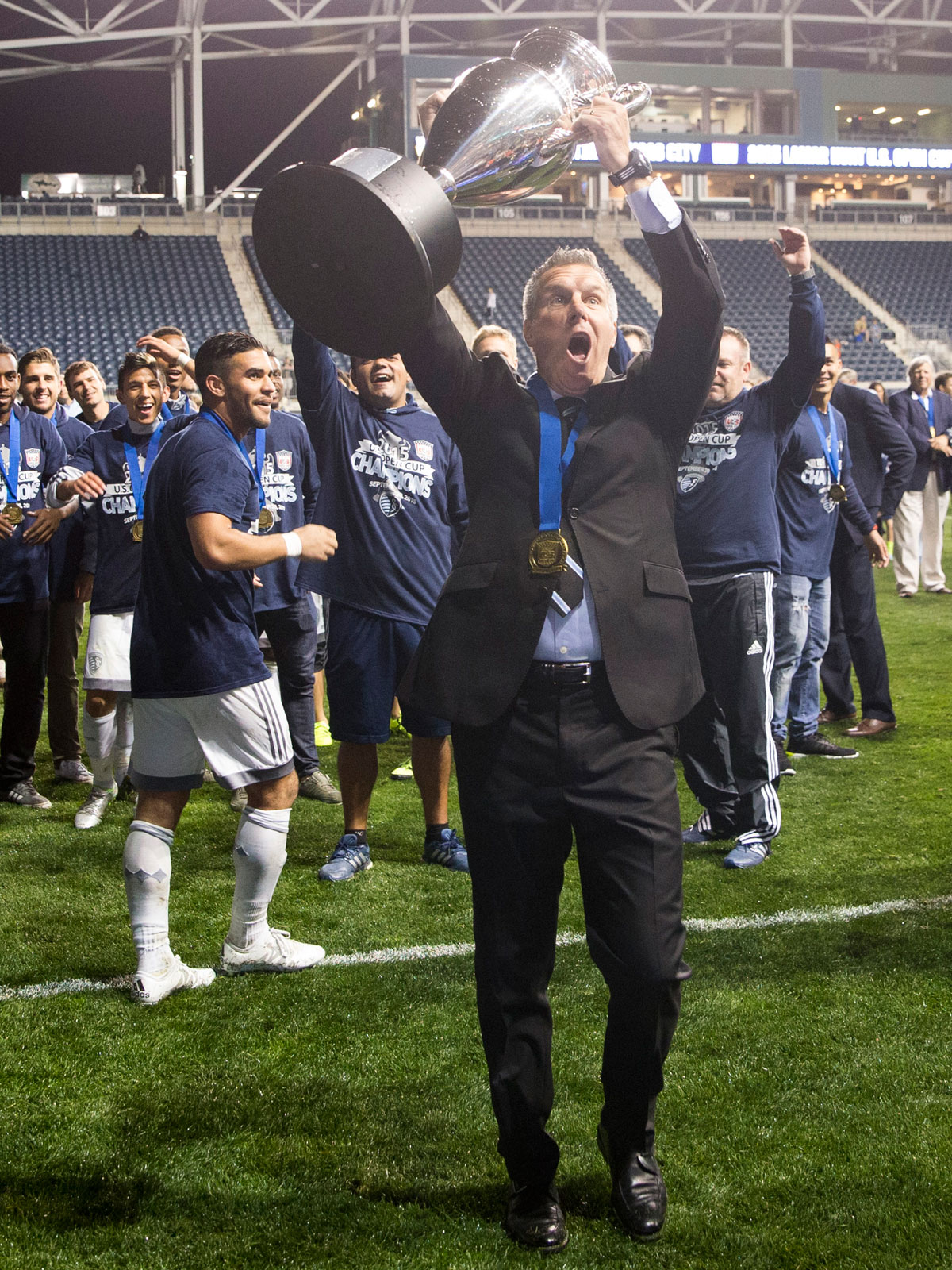 Peter Vermes lifts the 2015 U.S. Open Cup trophy with Sporting Kansas City
