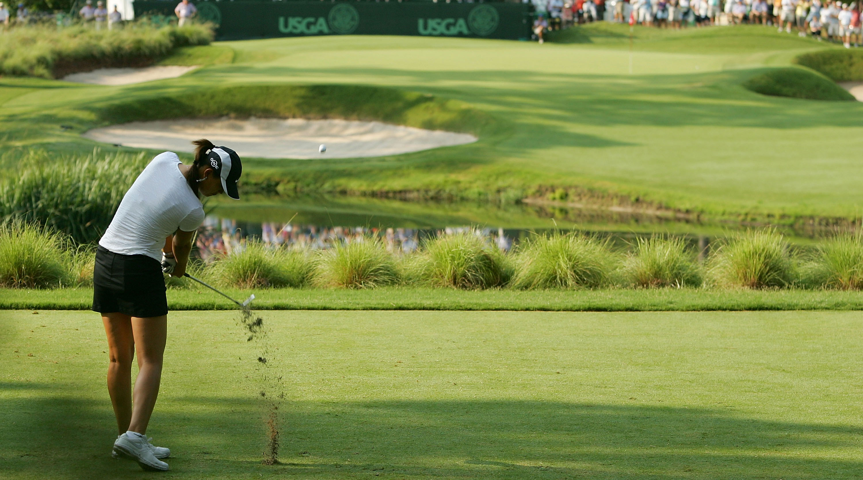 Michelle Wie plays her approach at Pine Needles' 2nd at the 2011 U.S. Women's Open.