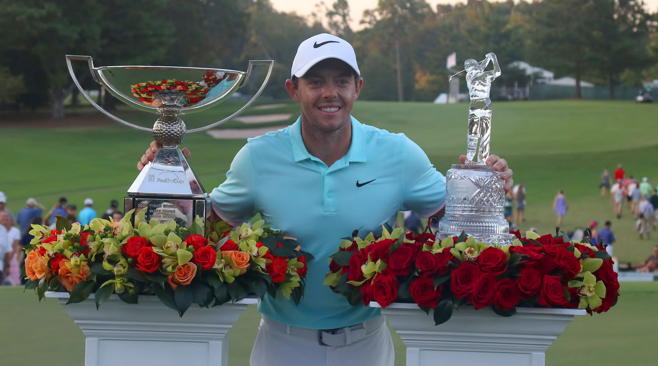 Rory McIlroy won both the FedEx Cup trophy (left) and the Tour Championshp trophy (right) at the 2017 finale.