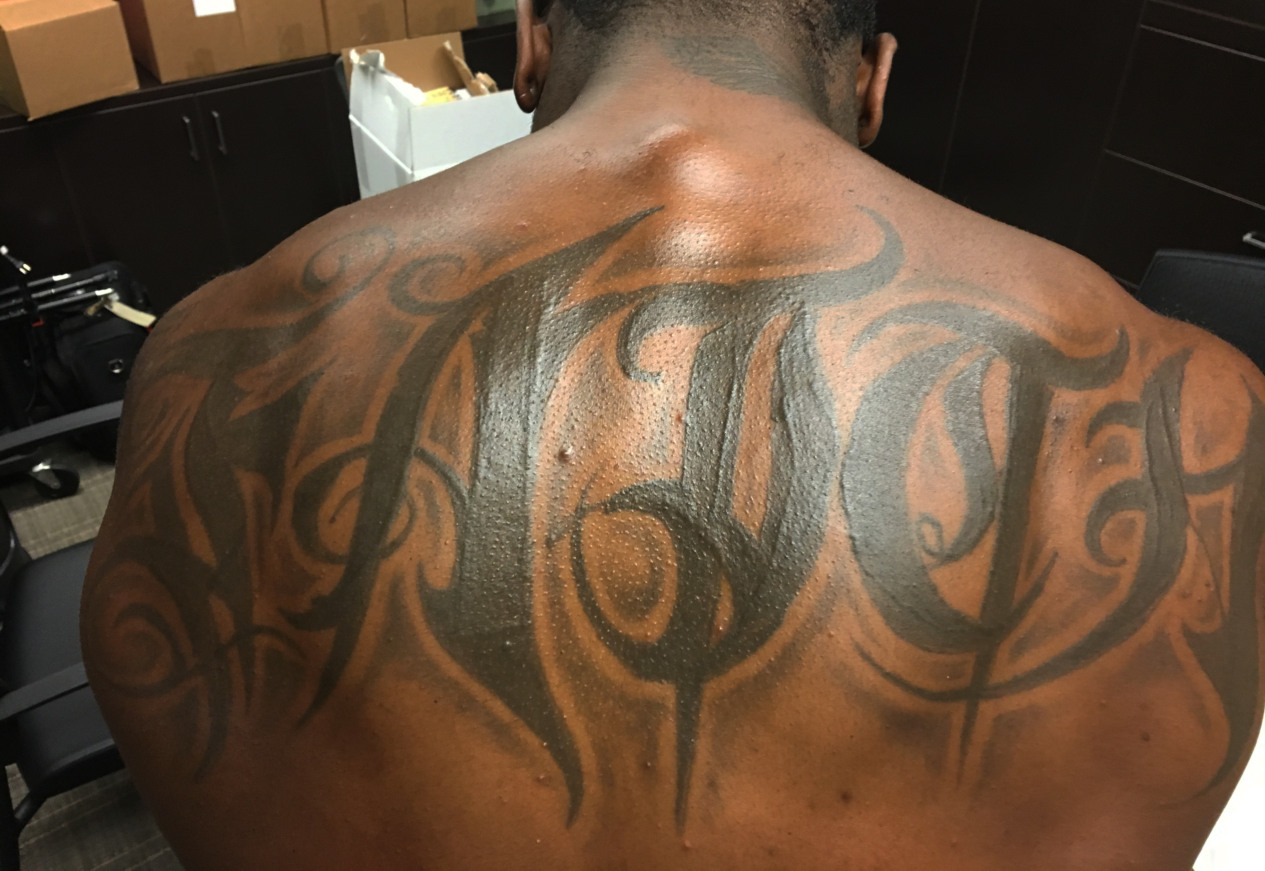 "Navorro Bowman, LB, San Francisco. ""I got it when I was 17 years old. 'Faith.' That word means everything to me. It goes all through me. I am committed in everything I do. It's God, but it's more than just God. When you're down, have faith that you will get back up. My work ethic—faith. When people see that tattoo, they think how big it is. The size of it, to me, shows how important faith is in every aspect of my life."""