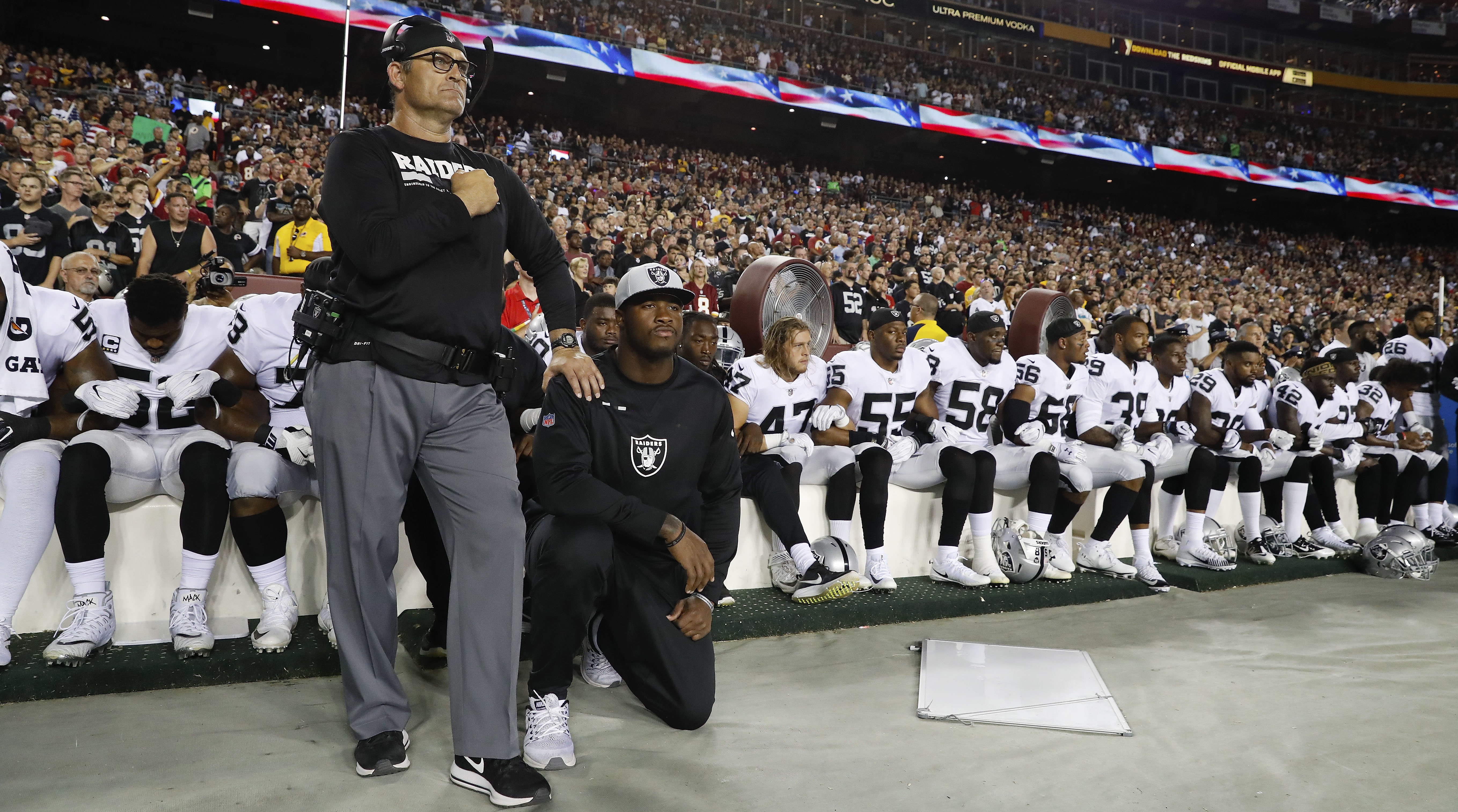 raiders national anthem protest majority of team stays seated si com