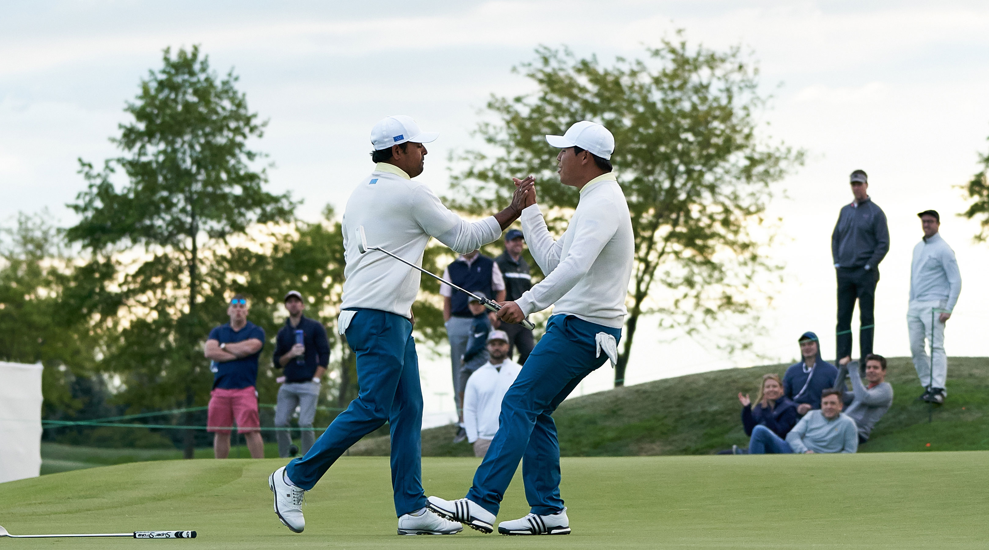 Lahiri, left, drained a clutch putt on 17 on Saturday evening.