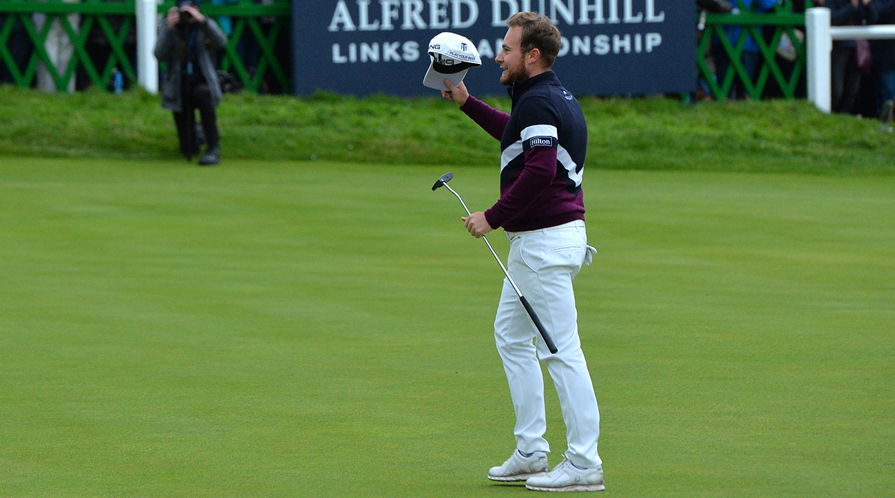 England's Tyrrell Hatton tips his cap after winning the Alfred Dunhill Links Championship in St. Andrews on Sunday.