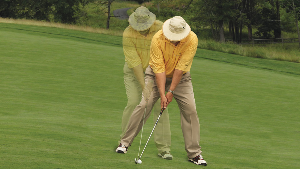 "On downhill lies, ""step"" down the hill so that your shoulders are parallel with the slope. On uphill lies, position the ball in front of where you typically take a divot."