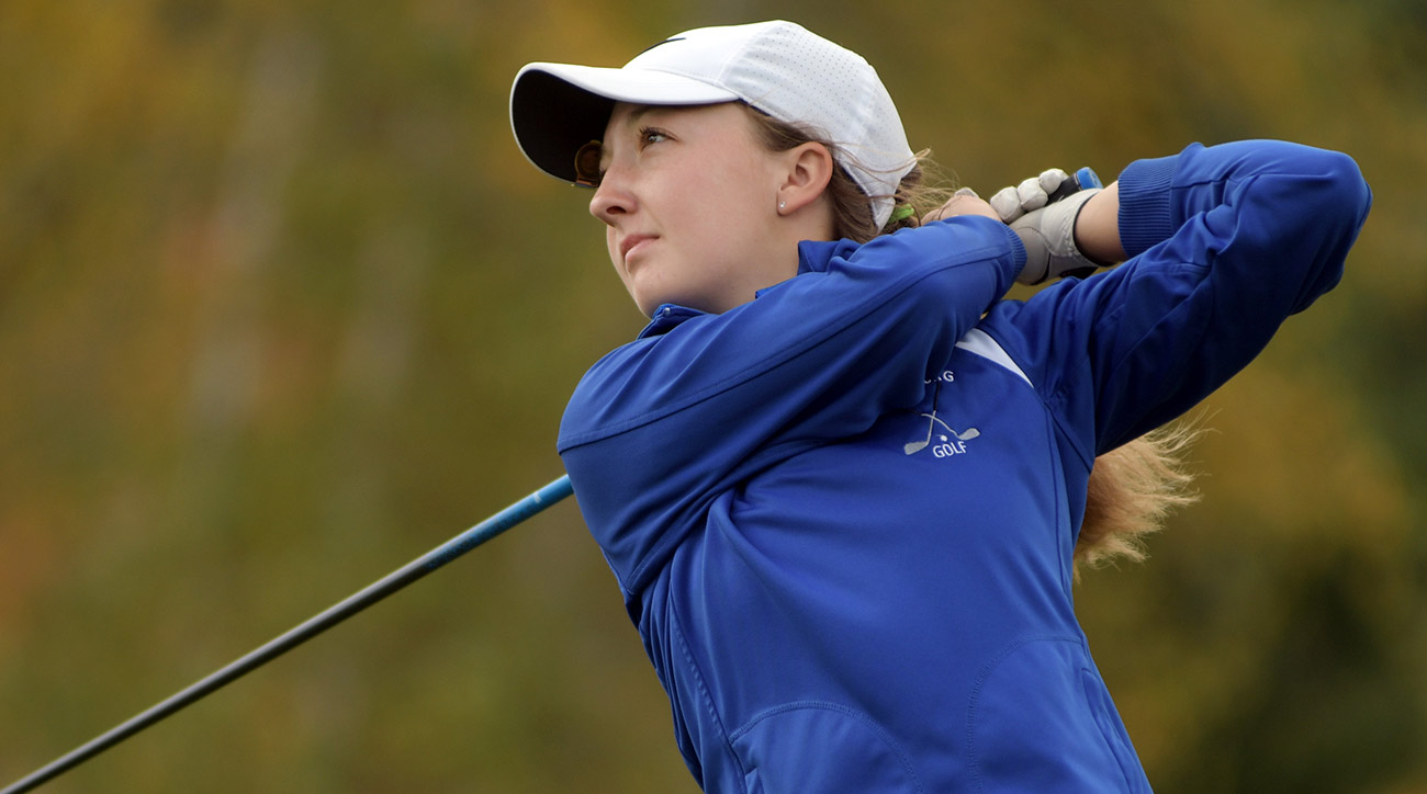 High schooler Emily Nash watches one of her drives during Tuesday's event.