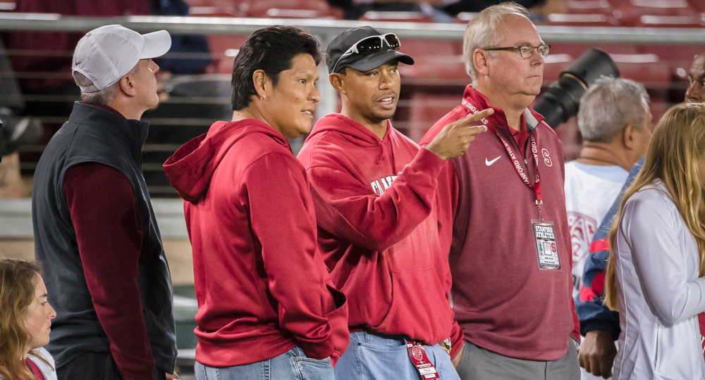 Tiger Woods and longtime friend Notah Begay watch the Stanford Cardinal football game against the Washington State Cougars on October 10, 2014.