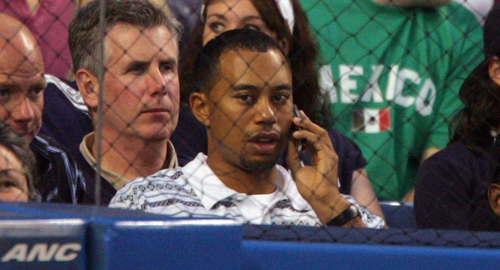 Tiger talks on his phone at a game between the New York Yankees and the Kansas City Royals in 2006.