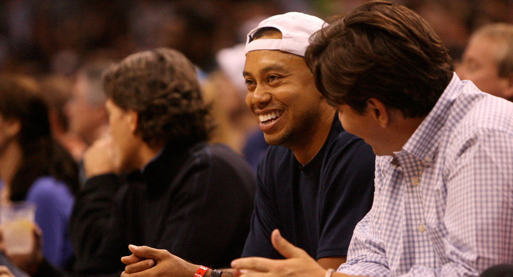 Tiger watches the game between the Orlando Magic and the Boston Celtics in 2010.
