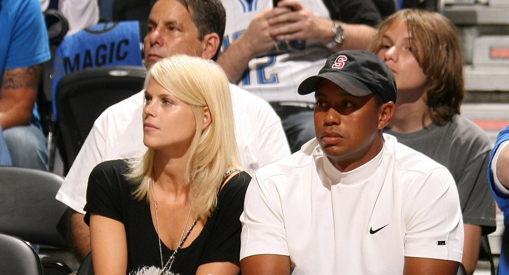 Tiger sits courtside with wife, Elin, as they watch the Los Angeles Lakers play against the Orlando Magic in Game Four of the 2009 NBA Finals.