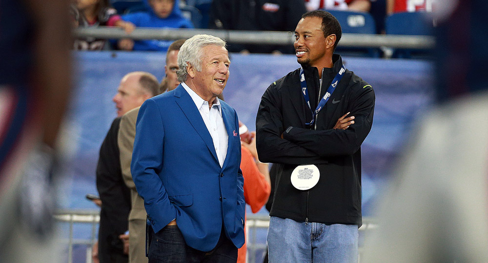 Tiger chats with New England Patriots owner Robert Kraft on the sidelines during the pre-game warmup for a game against the New York Giants in 2013.