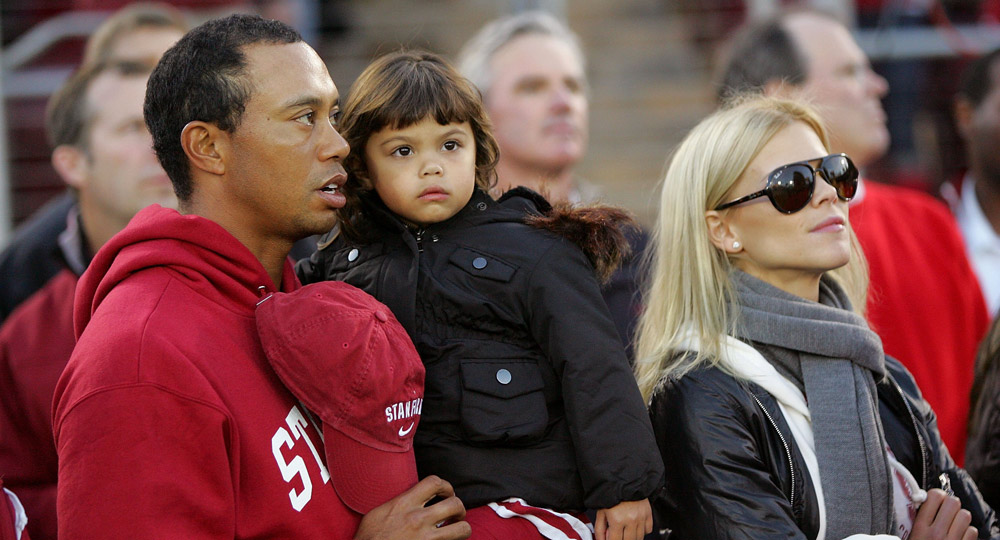 Honorary Standford Cardinal captain Tiger Woods, his daugher, Sam, and wife, Elin, stand on the sidelines before the Cardinal game against the California Bears in 2009.