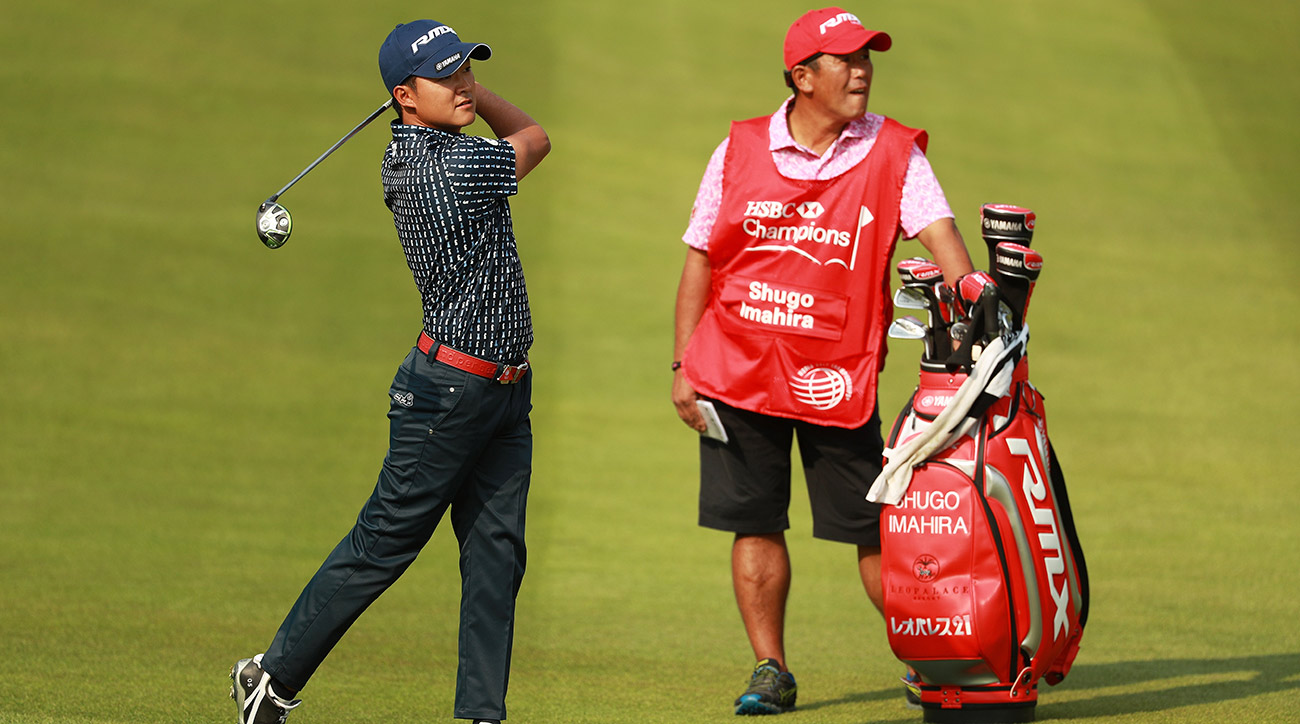 Shugo Imahira plays a shot as his caddie looks on during the second round of the WGC-HSBC Champions on Friday.