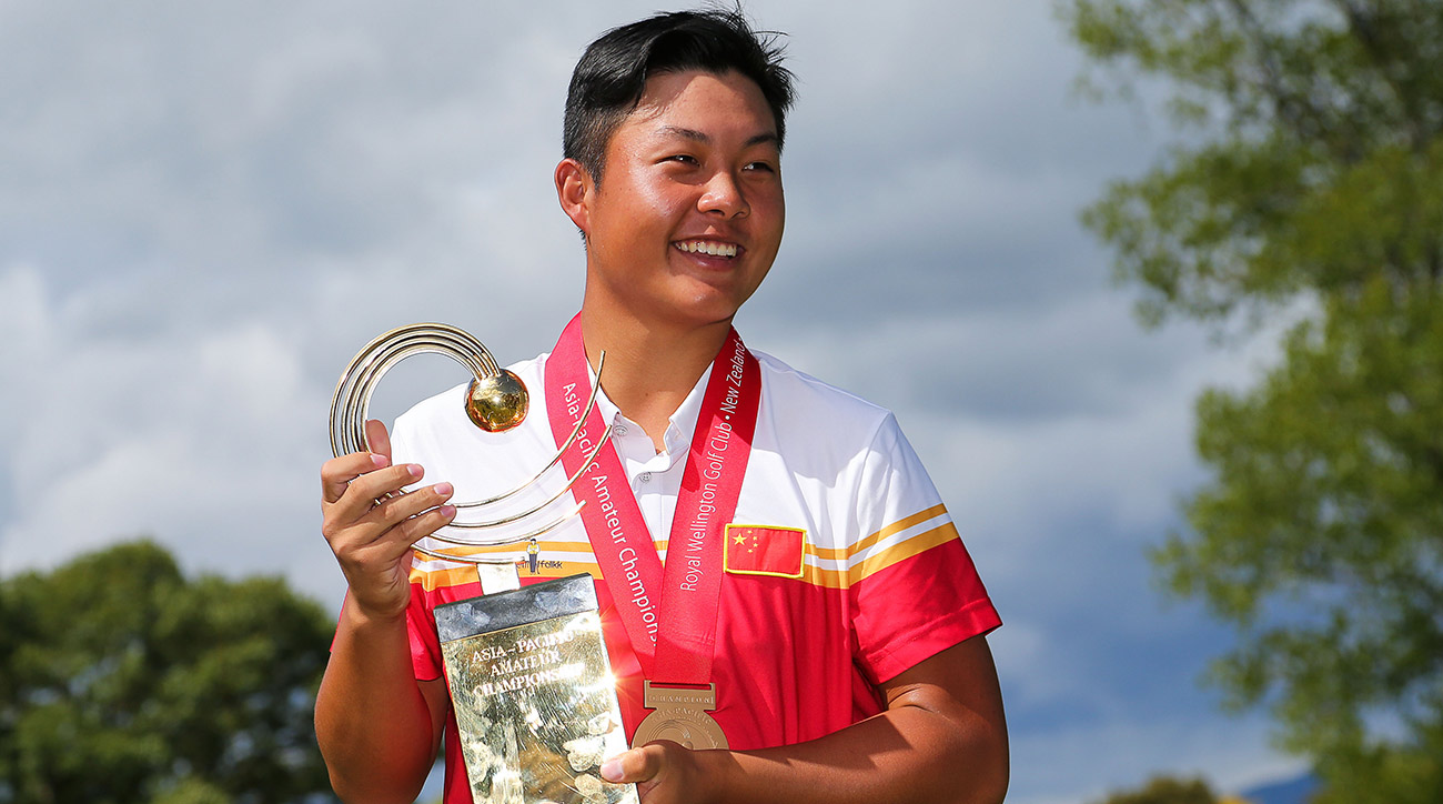 Lin Yuxin poses with the trophy after winning the Asia-Pacific Amateur Championship at Royal Wellington Golf Club on Sunday in Wellington, New Zealand.