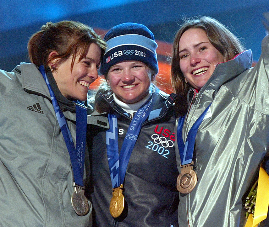 Kelly Clark of the US(C), Doriane Vidal of France (R) and Fabienne Reuteler (L) of Switzerland show their medals 10 February 2002 during the medals ceremony for the Women's Halfpipe snowboard competition at the 2002 Winter Olympics in Salt Lake City, Utah. Clark won the gold, Vidal the silver and Reuteler the bronze.